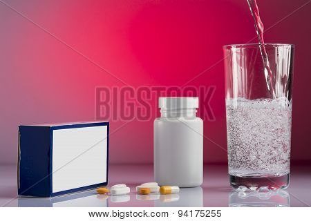 A various pills and glass of water