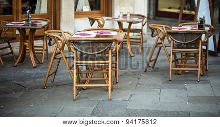 wooden chairs of a cafe