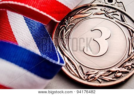 Bronze Medal Winner At The Light Background