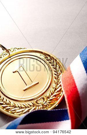 Gold Medal Winner At The Light Background