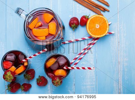 Strawberry Sangria On Blue Colored Wooden Background,