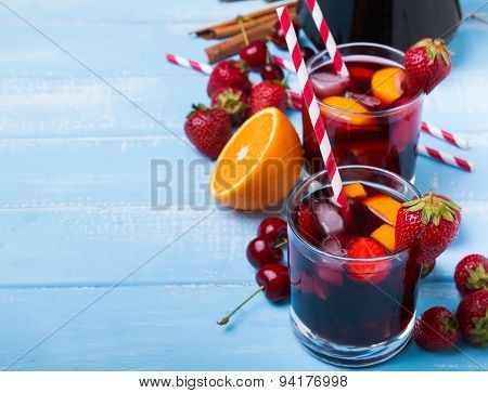 Sangria With Berries In A Glass On The Blue Wooden Background