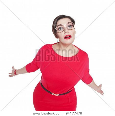 Surprised Plus Size Woman In Glasses Shrugs Her Shoulders
