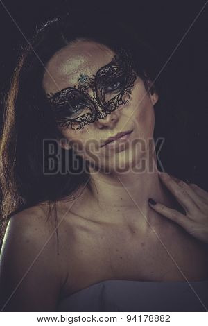 brunette woman in black mask metal frills