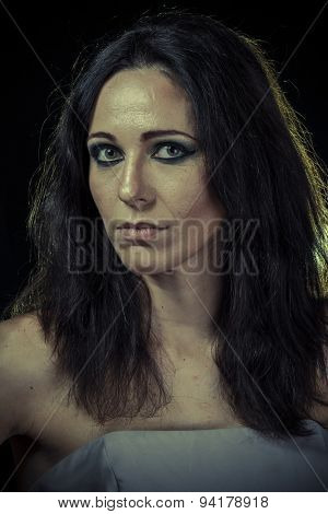 Divorce, sad brunette woman with long hair and evening gown