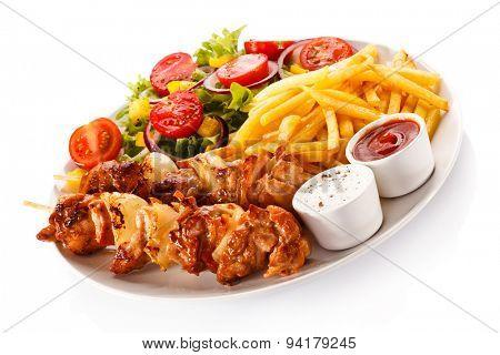 Shashlik - grilled meat, chips and vegetables