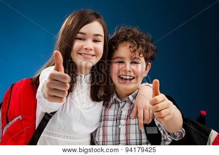 Students with backpack showing OK sign