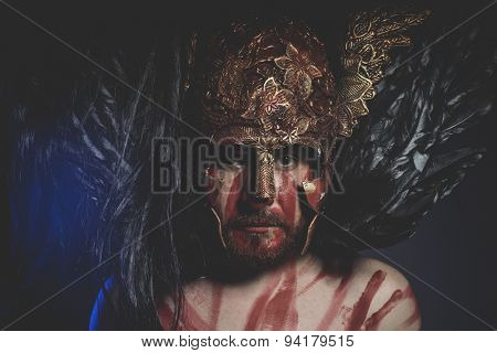 Mythology, bearded man warrior with metal helmet and shield, wild Viking