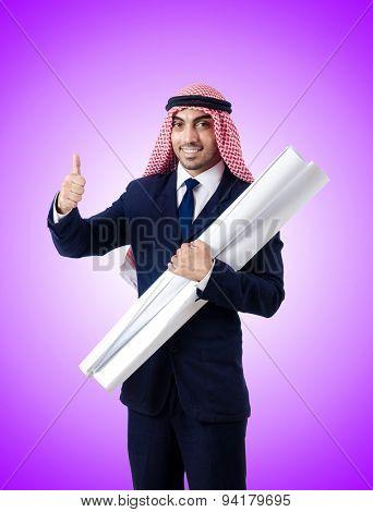 Arab engineer with drawings against gradient