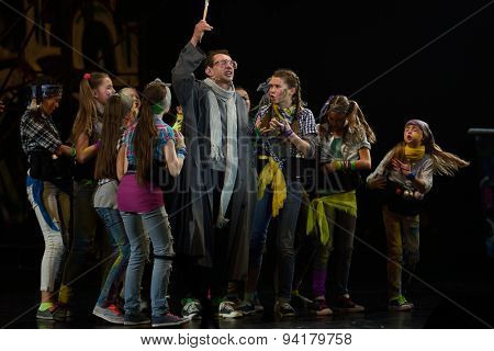 ST. PETERSBURG, RUSSIA - JUNE 19, 2015: Actor Konstantin Khabensky performs in a scene from a children's charity project titled Mowgli Generation. The performance is part of the SPIEF 2015