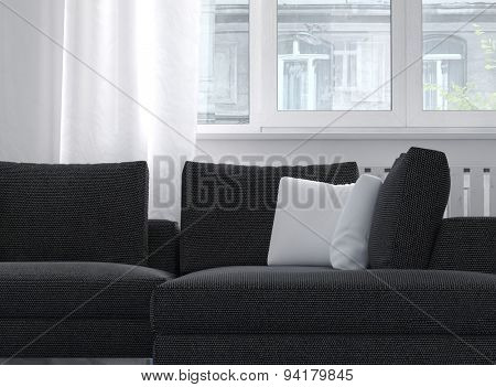 Close up of a charcoal colored comfortable classic upholstered sofa with cushions below a window with filmy white drapes. 3d Rendering.