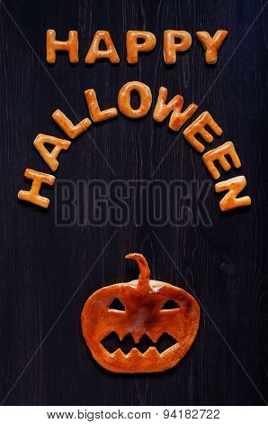 Letters and pumpkin of dough on the wooden table. Halloween background