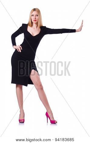 Young blonde girl in black pushing isolated on white