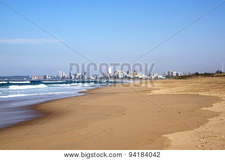 Low Tide At Durban Beach With City Skyline Background
