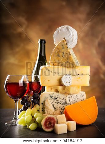 Various types of cheese on stone table, still-life.