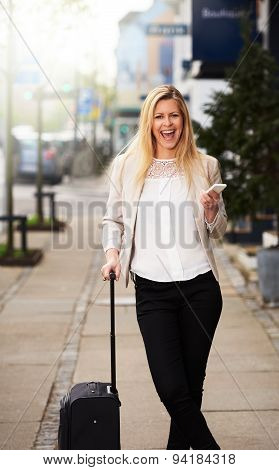 Professional Woman Posing On Sidewalk Grinning