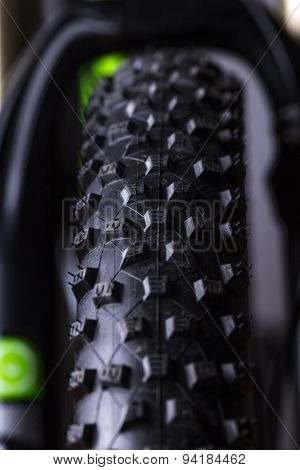 close-up of a green mountain bike, studio shot.