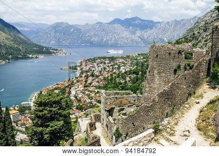View Of The Roofs Of The Houses And The Marina With A Fortress Wall In The Old Town Of Kotor