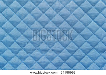 Blue Quilted Synthetic Fabric With Grained Texture