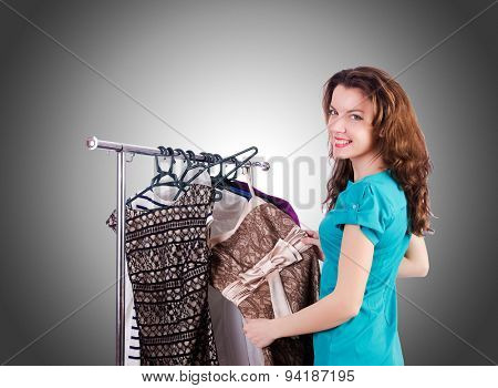 Woman trying new clothing against gradient