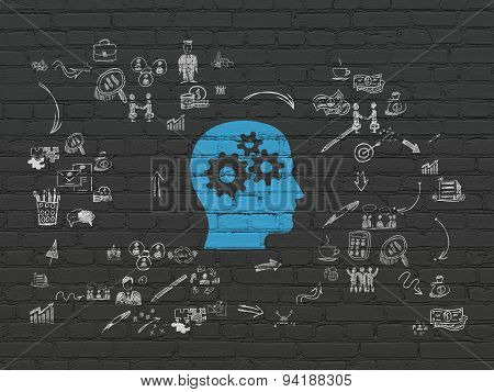 Finance concept: Head With Gears on wall background