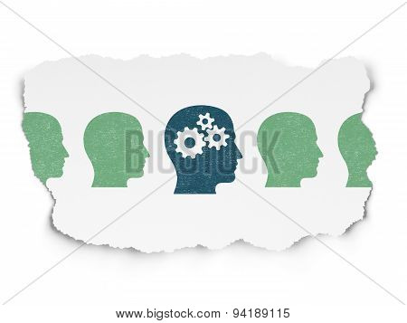 Finance concept: head with gears icon on Torn Paper background