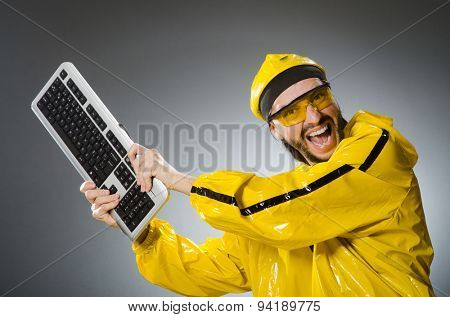 Man wearing yellow suit with keyboard