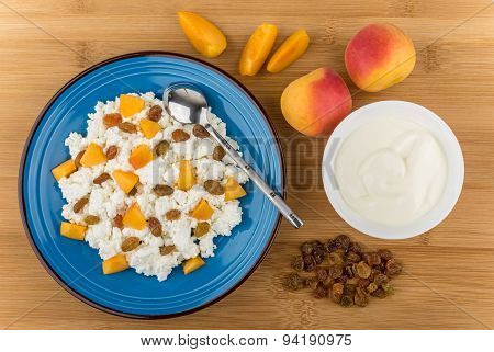 Curd In Blue Plate With Peaches And Raisins, Sour Cream