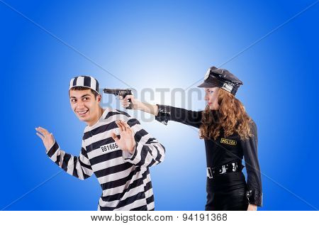 Police and prison inmate against the gradient