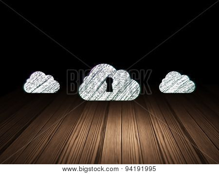 Cloud computing concept: cloud with keyhole icon in dark room
