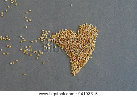 Raw Whole Grains of Quinoa in Heart Shape