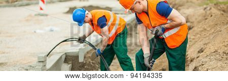 Workers Are Digging A Hole