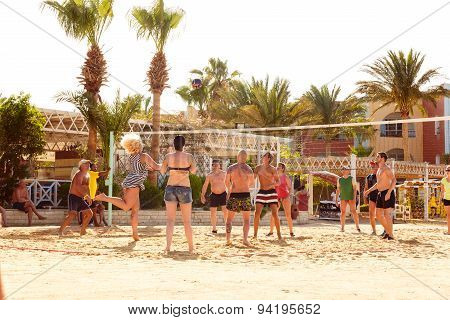Young Tourists Playing Volleyball