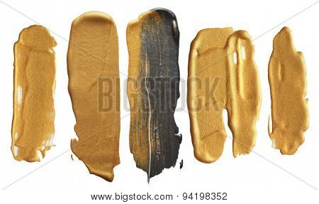 Abstract gold acrylic and watercolor brush strokes.