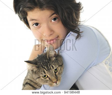 Close-up of an attractive young teen snuggling with her pet cat.