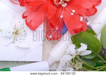 Office Table With Flower, Ribbons, Pencil, Candles