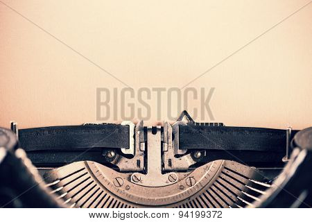 Detail of vintage typewriter with blank paper for text