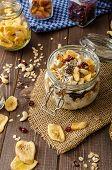 stock photo of dry fruit  - Homemade yogurt with granola dried fruit and nuts bio  - JPG