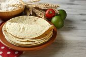picture of whole-wheat  - Stack of homemade whole wheat flour tortilla and vegetables on plate - JPG