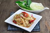 image of green papaya salad  - Papaya Salad Spicy Thai Food on White Dish - JPG