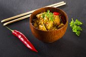 picture of curry chicken  - Chicken curry in a wooden bowl - JPG