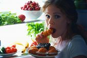 image of sneak  - woman eats sweets at night to sneak in a refrigerator - JPG