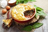 picture of nettle  - Pie nettles rice and canned fish on the table - JPG