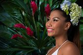 picture of filipina  - Beautiful woman with flowers in her hair in tropical forest - JPG