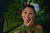 image of filipina  - Portrait of attractive woman in jungle smiling at camera - JPG