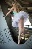 pic of tutu  - Graceful ballerina in white tutu in the industrial background of the bridge - JPG