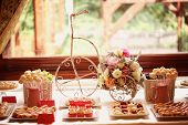 stock photo of sugarpaste  - Capture of Table setting with flowers and sweets - JPG