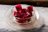 pic of sorrel  - Frozen hibiscus tea also known as karkade agua fresca or red sorrel on a marble plate - JPG