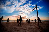 picture of volleyball  - Beach volleyball silhouette at sunset - JPG