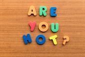 stock photo of irresistible  - are you hot colorful words on the wooden background - JPG